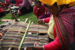 Celia Weaving on a backstrap loom