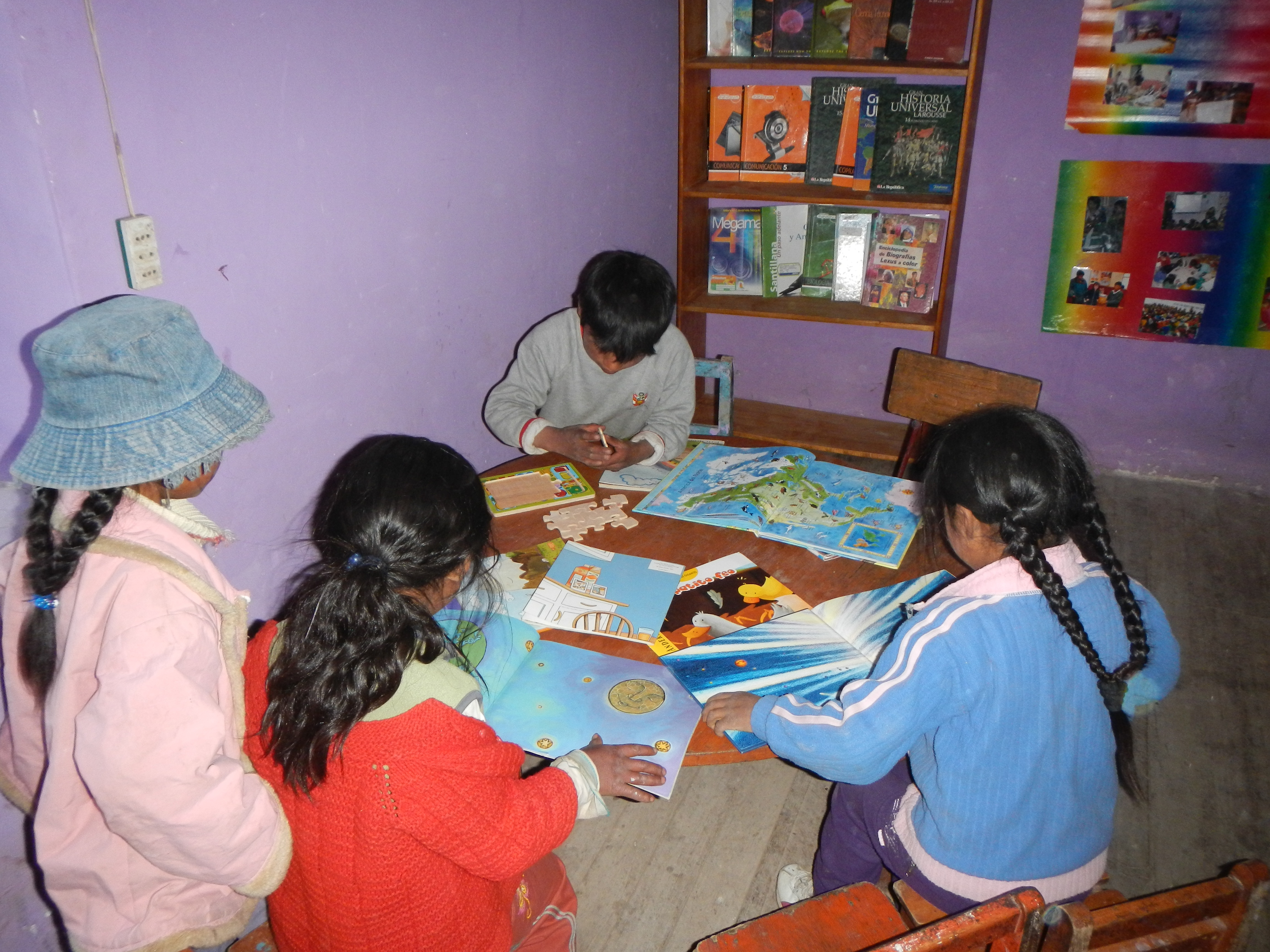 Quechua youth solving a puzzle