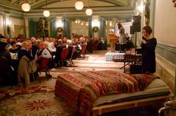 Ashli presenting a woven bedspread