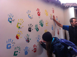 Colourful painted hand-prints