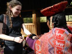 Student meeting Quechua woman