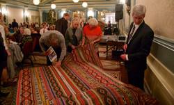 Admiring the handwoven bedspread