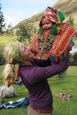 Mosqoy volunteer holding baby