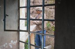 Quechua man through a window