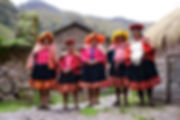 Five Quechua women wearing traditional shawl, skirt and hats