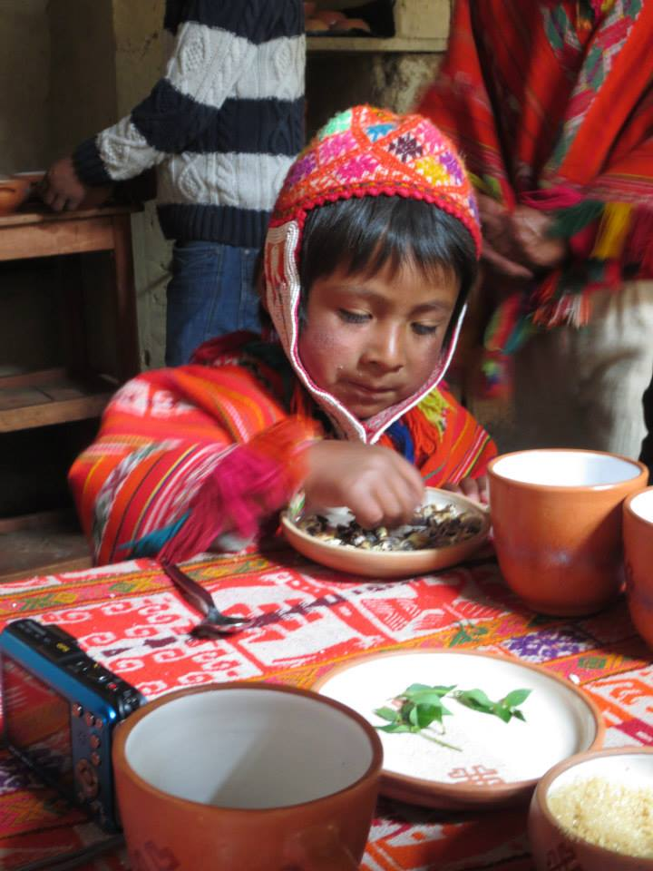 Young Quechua boy eating