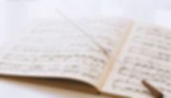 Conductor's baton on sheet music
