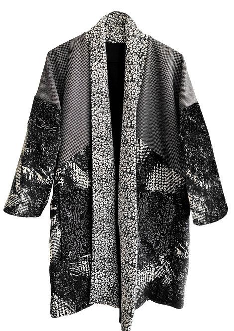 מעיל דו-צדדי טלאים שחור לבן