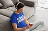 Man listening to the Dynasty Drunks Fantasy Football Podcast in Blue Shirt