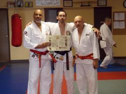 New Shodan with Soke Claudio and Sensei Armstrong