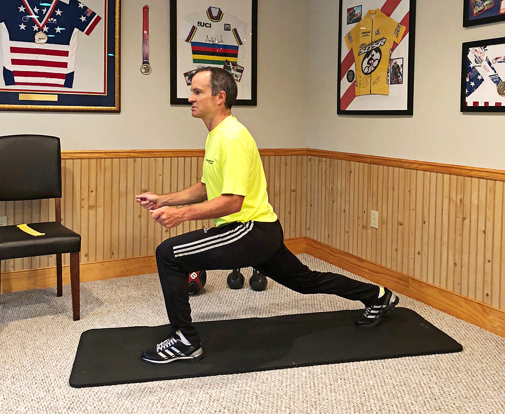 Tim Cusick demonstrates a lunge strength training for cyclists