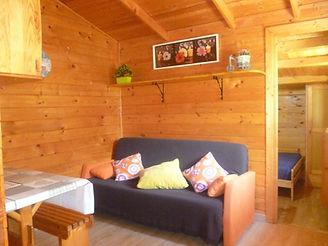 salon con sofa cama cabaña grande