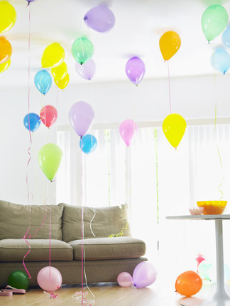 Living room full of colorful balloons by