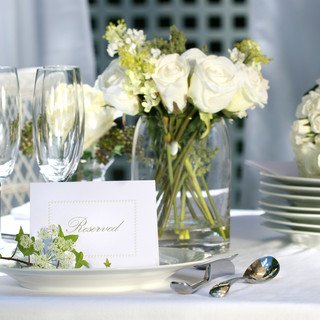 White place card on outdoor wedding tabl