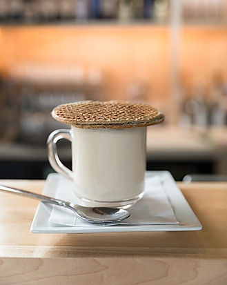 specialty espresso drinks from our bar with homemade stroopwafel