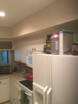 Stove/cabinets before