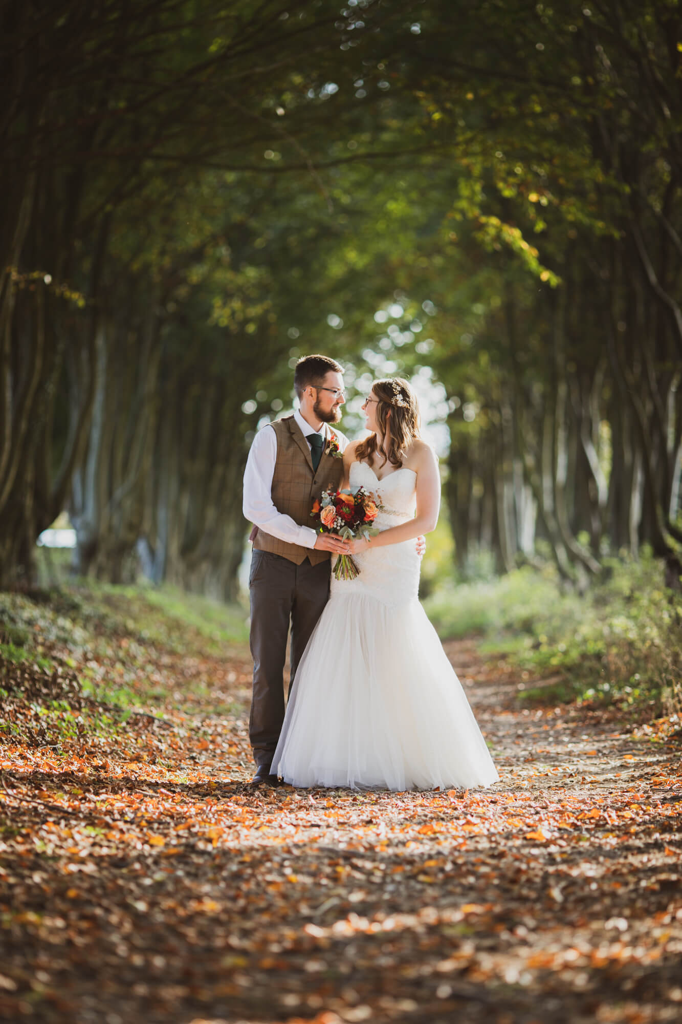 bride and groom, in trees, Wiltshire wedding photographer