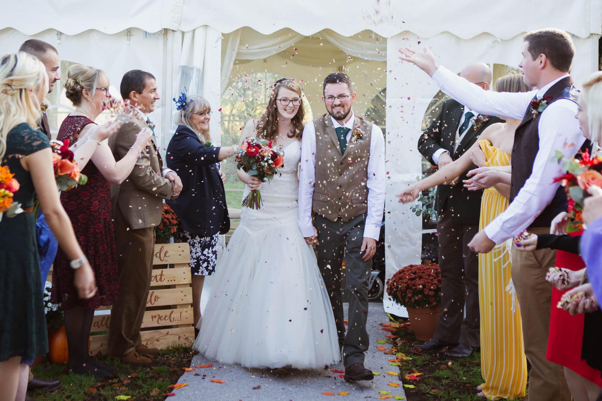 Salisbury wedding photographer, confetti, bride and groom