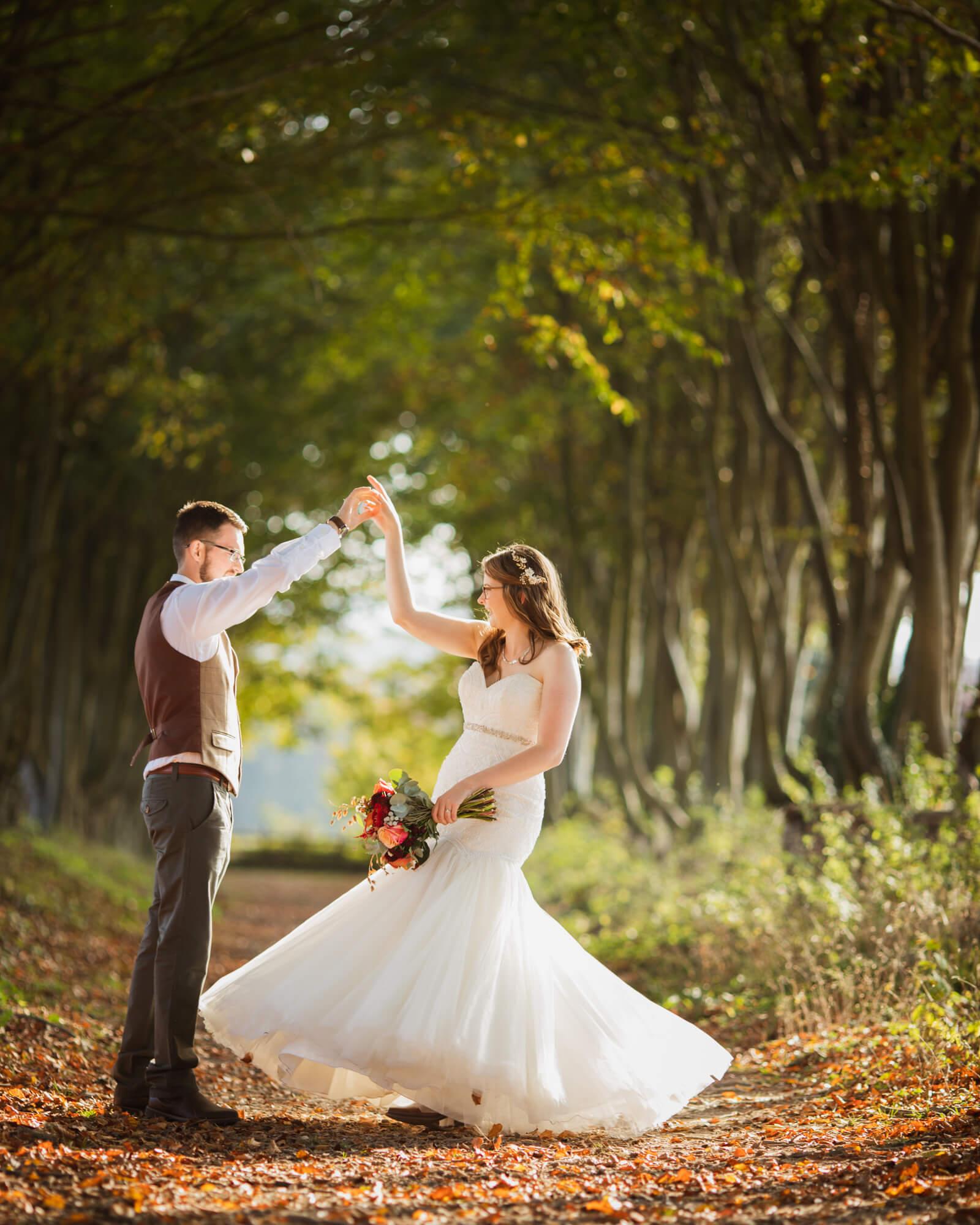 bride and groom dancing, Wiltshire wedding photographer
