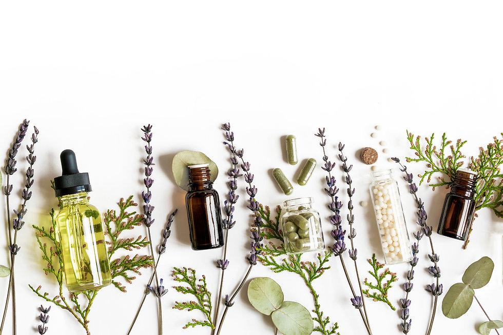 Homeopathy eco alternative medicine concept - classical homeopathy pills, thuja, eucalyptu