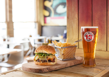 Pint of Hop House Lager with Burger and fries
