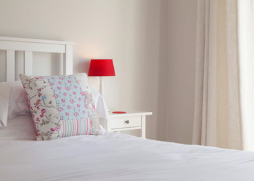 Bed with patterned cushion