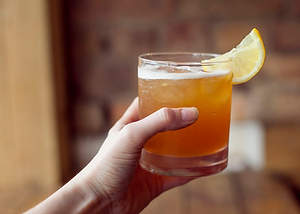 Amaretto Sour with Lemon Wedge
