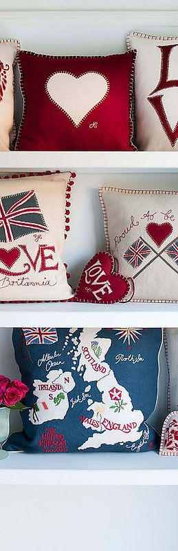 A white shelf with Jan Constantine cushions on it.