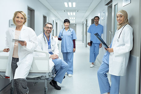 Front view of happy diverse doctors and