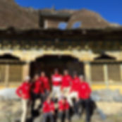 The Team Posing in Front of the Mu Gompa