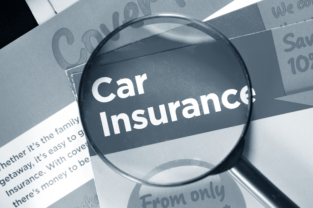 car insurance under magnifying glass