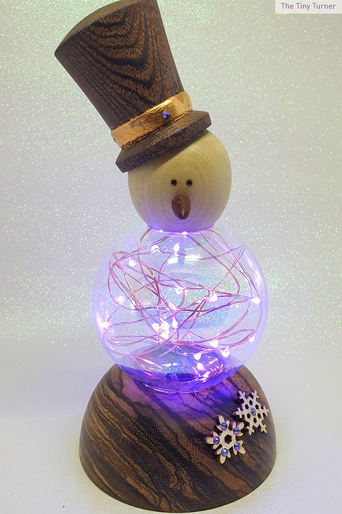 Snowman Ornament with Purple LEDs on a Zebrano Base