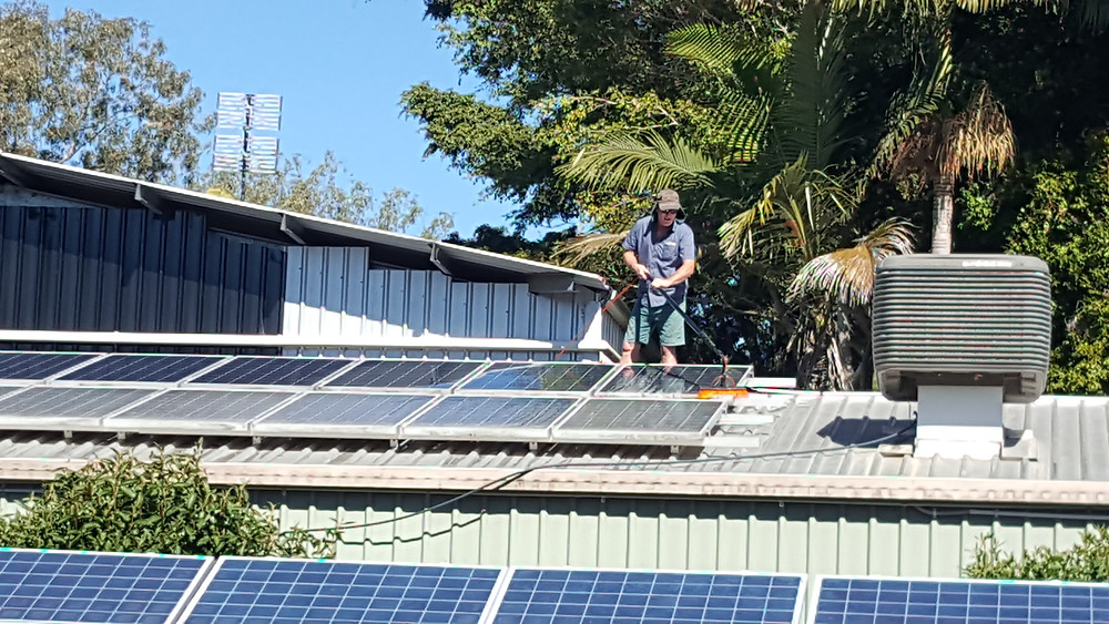 Terry while cleaning solar panels