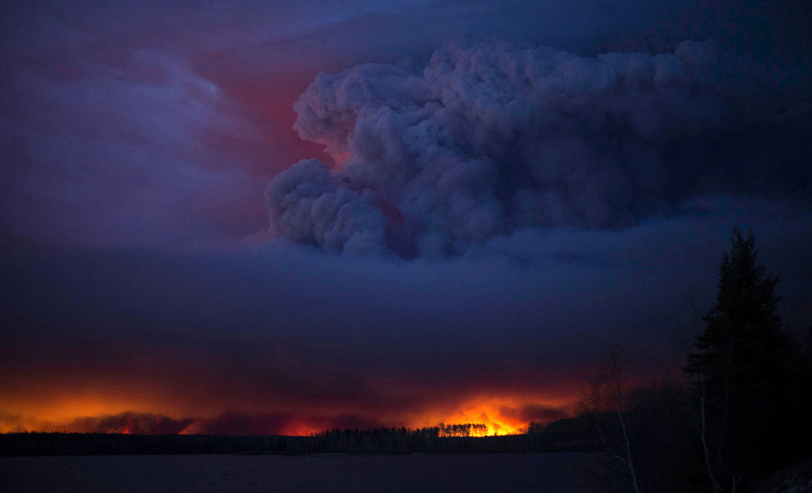 An wildfire rages unchecked in Alberta, Canada