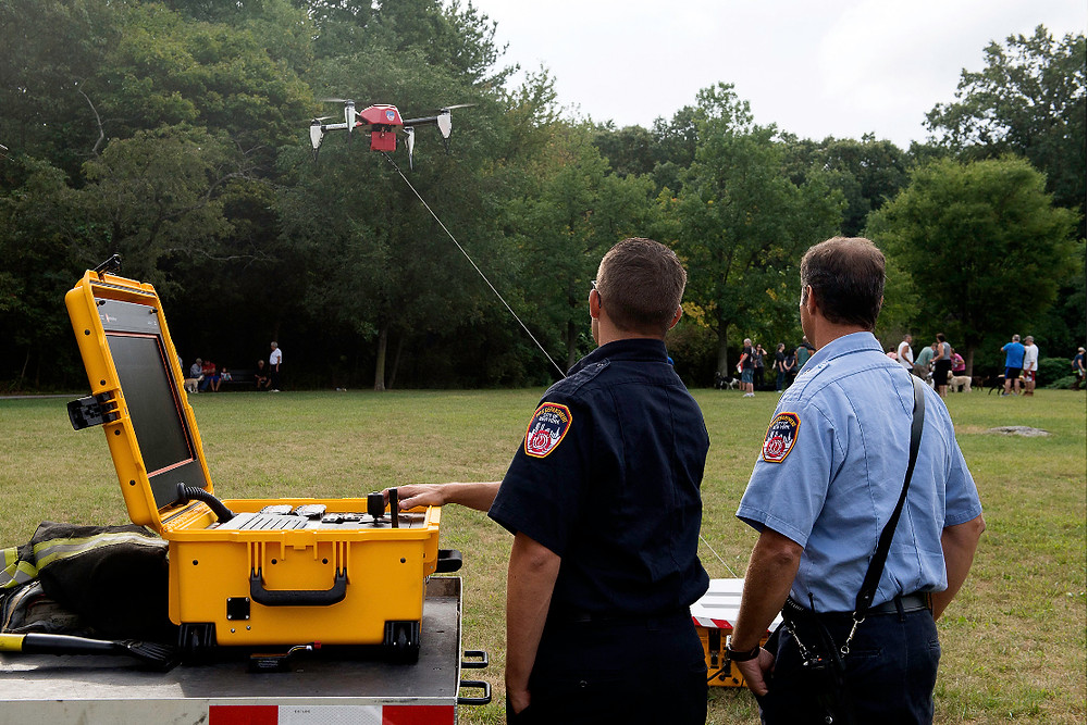 Fire Department Personnel Using Tethered Drone