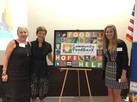ArtWare presenting Sobel & Co with the mural they created in a team building session for Community Food Bank of NJ