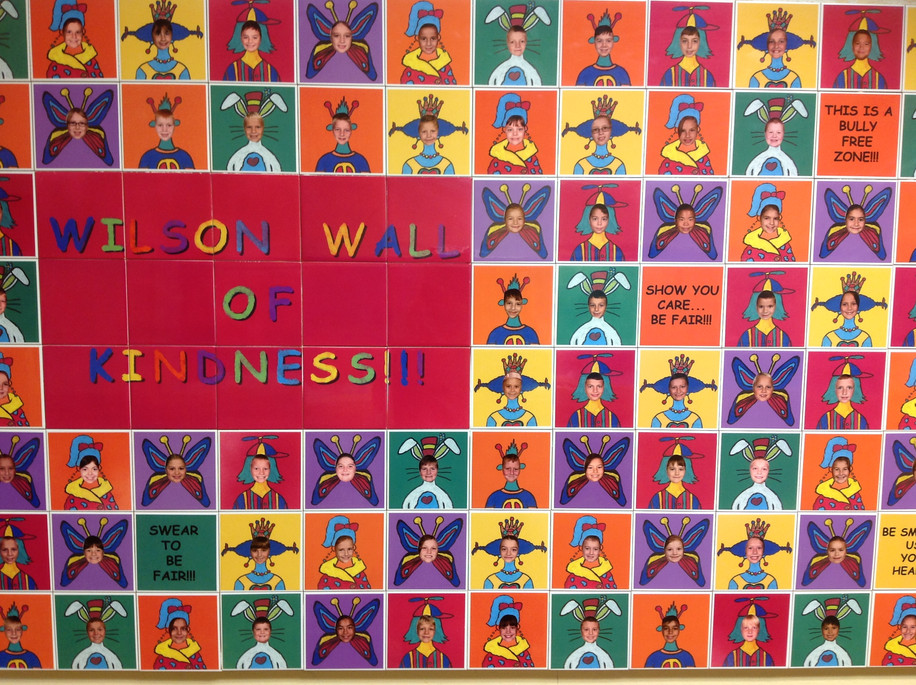 A wall of Kindess - colorful, bright and fun tiles created with cutouts and photos of the entire student body at Wilson Elementary in NJ