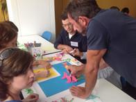Teachers at Lycee Francais brainstorming for the art tile mural for Edeyo Foundation in Haiti
