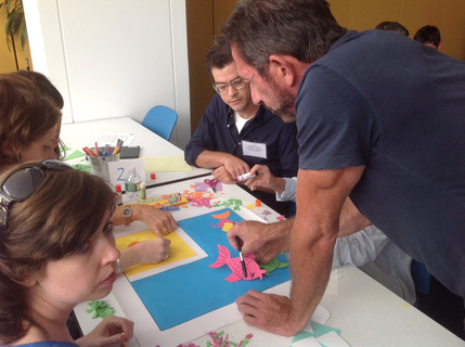 Teachers at Lycee Francais brainstorming for the art tile mural for Edeyo Foundation in Haiti