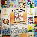 Celebrating 10 years of Pelican Pride at Coral Cove Elementary in Florida - a branded legacy tile wall