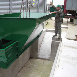 Dump pit hopper lowered into place