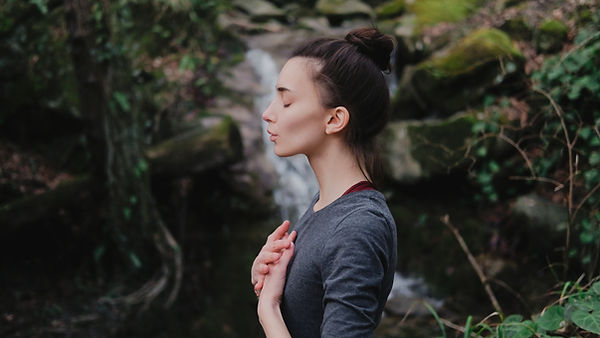 Young woman practicing breathing yoga pr