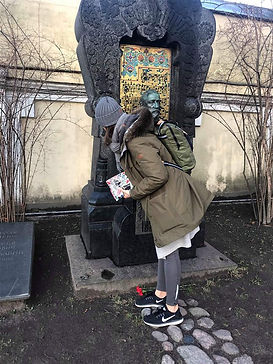Artist assistant placing a hand on Alexander Bordin tombstone
