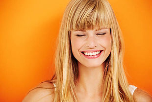 woman smiling orange.jpg