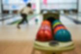 bowling balls on rack.png