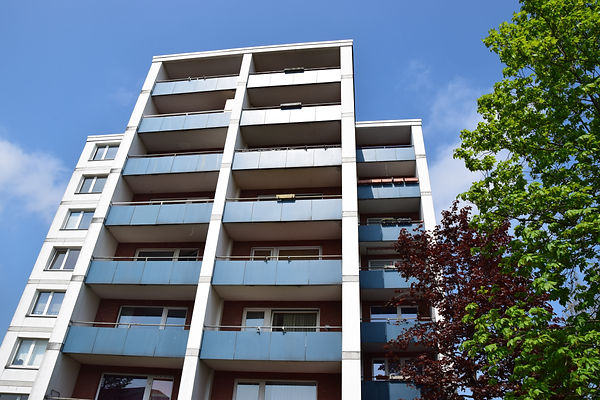 Multi-storey tenement with blue balconie