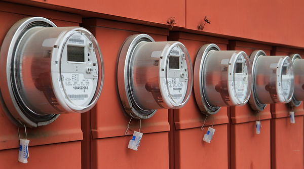 Line up of five electric power meters on