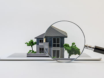 house miniature model on tablet pc and m
