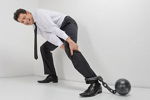 Chained businessman. Full length of hope
