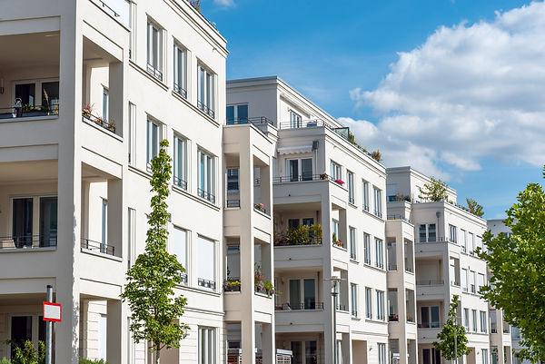 WEG - Row of white modern apartment hous